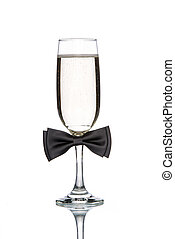 Glass of champagne with black bow tie