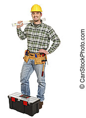 manual worker and tools - young standing manual worker and...