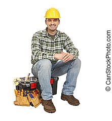 young manual worker and toolbox - young handyman sit on his...