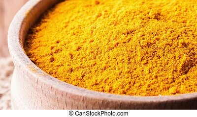 dry spice turmeric in a wooden bowl