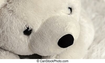 white soft toy bear in a children's room