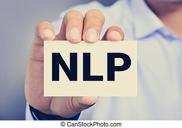 NLP letters (or Neuro Linguistic Programming) on the card...
