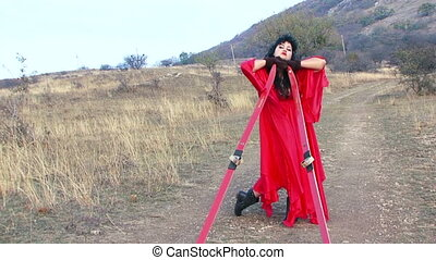 Weird Female Standing In The Field With Skis