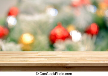 Wood table top on blur colorful christmas ornament...