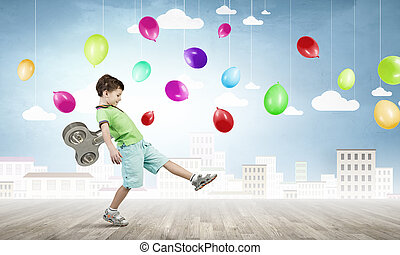 Hyperactive happy child - Little cute active boy with key on...