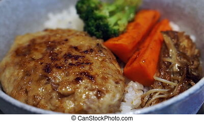 pork burger over rice japanese food - pork burger served...
