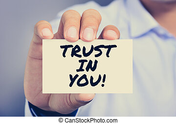 TRUST IN YOU!, message on the card held by a man hand,...