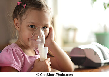 Lovely little girl with inhaler - Portrait of a lovely...