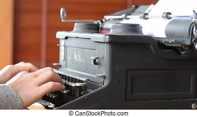 Writer writing on typewriter