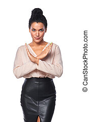 Business woman showing stop hand sign - Serious mixed race...