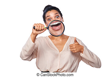 Woman smiling and show teeth through a magnifying glass -...