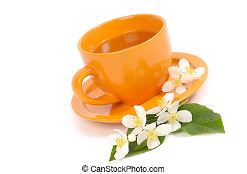 Green Tea with Jasmine flowers. Shallow DOF