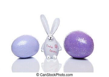 Cute Easter bunny with big ears between easter eggs - Cute...