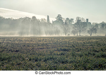 Low fog morning winter time in Northern Italy
