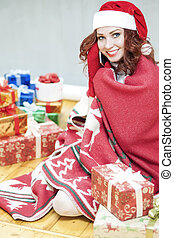 Pretty and Laughing Red-Haired Cucasian Santa Girl With a...