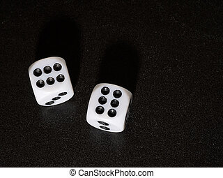Winning streak Dice showing number 6 on black textured...