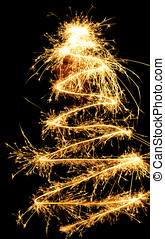 sparklers chistmas tree against black background