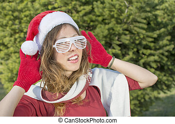 Portrait of a beautiful Santa Claus girl with party glasses...