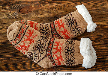 knitted socks with fur lining on a wooden surface