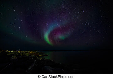 Northern lights on a shore - Greenlandic northern lights,...