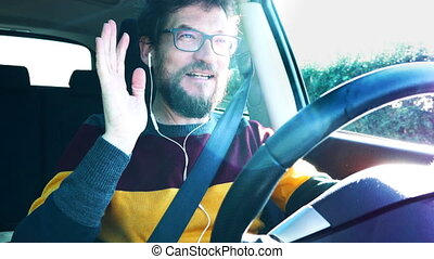 man driving saying goodbye on the phone - man saying goodbye...