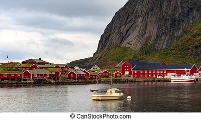 Reine timelaspe in Lofoten Islands, Norway - Fishing boat in...