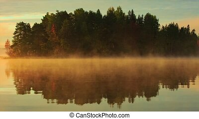 Moving fog over lake
