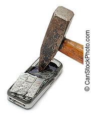 Smashed mobile phone - Hammer smashing cellular phone...