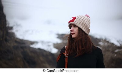 Woman hiker looking at mountain landscape.