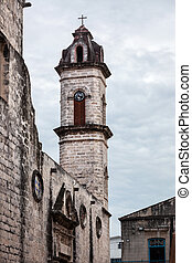 old bell tower on background cloudy sky