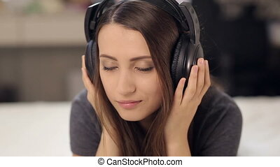 Attractive Woman in Love Listening Music in Bed