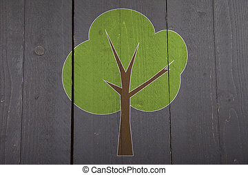Green tree on black wooden background