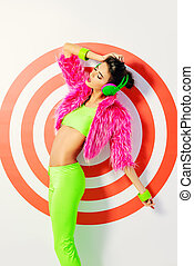 dynamics - Trendy DJ girl in bright colorful clothes and...