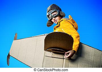 fantasy world - Eight-year boy playing with a cardboard...