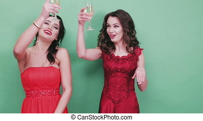 Two young ladies poured champagne