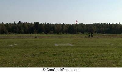 Airfield. View of people watch airplane takeoff - Airdrome....