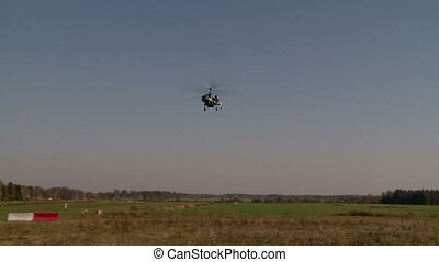 View of helicopter flies to landing ground - Airdrome. View...