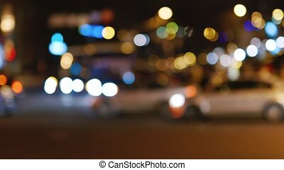 Night road with cars in blurred image