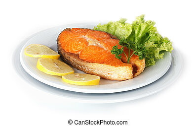 Roasted Salmon plated with lemon isolated on white