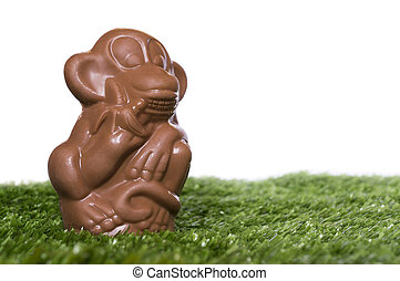 Chocolate monkey on the grass - A chocolate figure of monkey...
