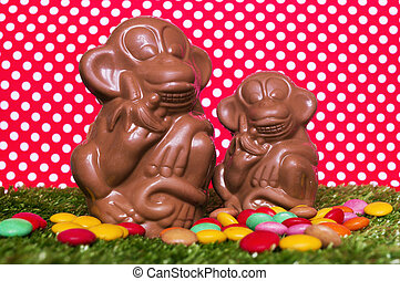 Chocolate monkeys on the grass - The chocolate figures of...