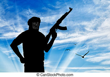 Silhouette of a terrorist with a weapon