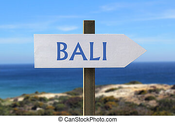 Bali sign with seaside in the background