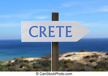Crete sign with seaside in the background