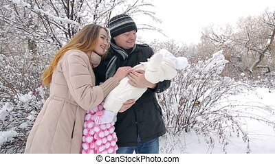 Young Family in Winter - Young Happy Family with baby