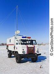 Khaky heavy resque military truck,car on blue sky with...