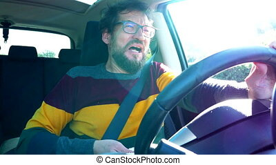 Sick man in car driving - Sick man driving car sneezing and...