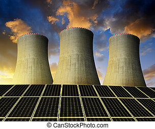 energy concept - Solar energy panels and nuclear power plant...