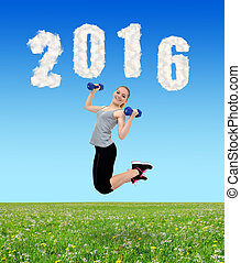 girl jumps with dumbbells - Happy healthy active girl jumps...