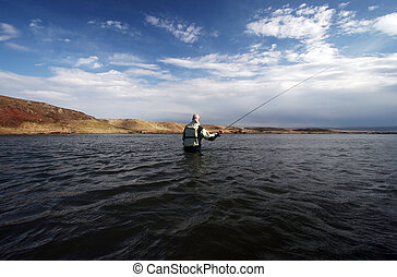 Flyfishing - Flyfisherman casting in calm waters